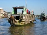 Vivre sur un bateau dans le delta du Mékong, Cái Be, Vietnam