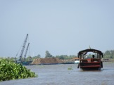 Transport du sable, delta du Mékong, Vietnam