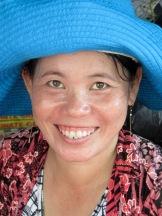 Le sourire d'une marchande au marché de Chau Doc, Vietnam