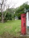 La présence anglaise a laissé des traces à Belize City, comme cette boîte aux lettres. Nous en trouverons plusieurs sur notre parcours. Belize District, Belize.